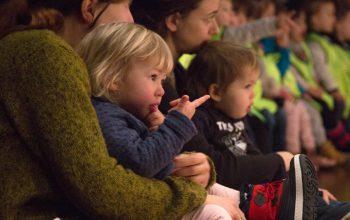 Children watching a theatre show